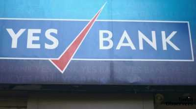 A closeup of the trademark brand logo of Yes bank, in Colaba causeway