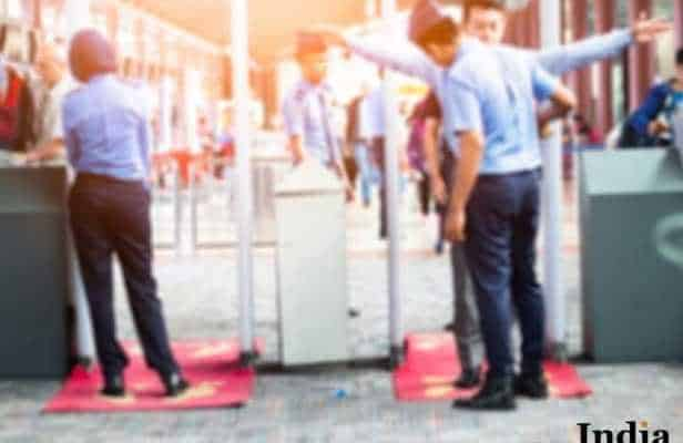 Blurred Airport security check at gates with metal detector and scanner to prevent from Corona Virus