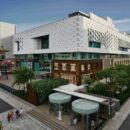 reliance industries unveils jio world drive in mumbai housing international brands and open air community markets